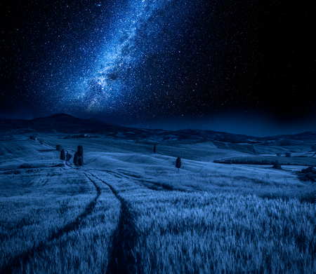 Fields of wheat and milky way in Tuscany, Italy