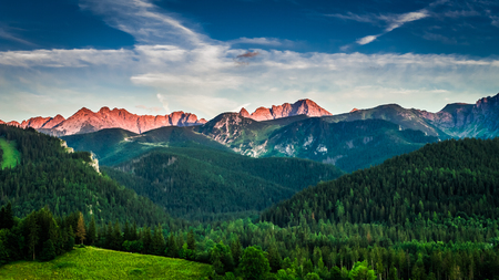 Red sunset in mountains in summer, Poland, Europe