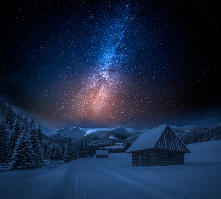 Milky way and snowy footpath at night in Tatra Mountains