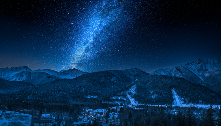 Zakopane at night with milky way in winter