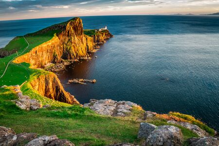 The Neist point lighthouse at dusk, Scotland, UK Foto de archivo
