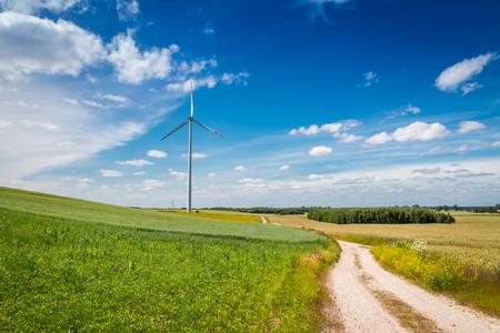 Wind turbines as alternative energy on green field 版權商用圖片