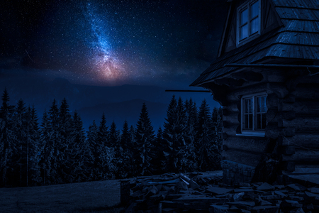 Rural cottage and milky way in the mountains at night