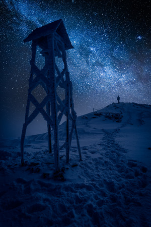 Man looking to stars in the top of mountain Stock Photo