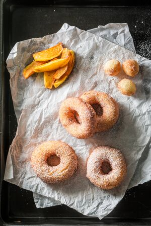 Homemade sweet donuts with powdered sugar on paper