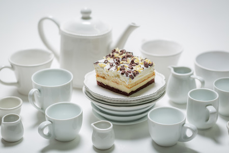 Delicious white cake with mousse, chocolate and porcelain