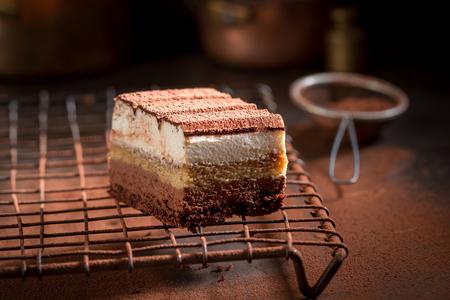 Tasty tiramisu cake with cocoa, mascarpone and biscuits