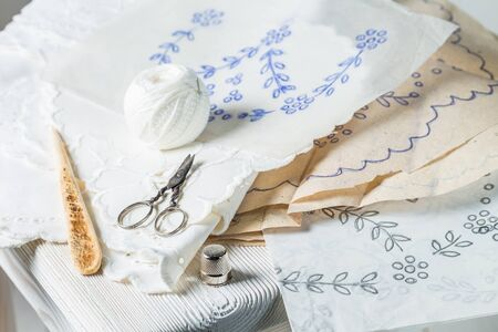 Closeup of handmade embroidered napkins with white thread