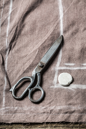Scissors, cloth and tailor draft of trousers