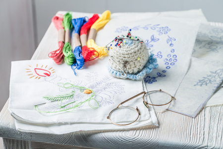 Embroidered napkins with color mulina on white table