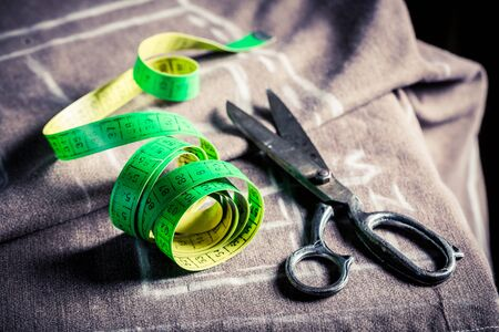 Closeup of tailors table with cloth and scissors Stock Photo