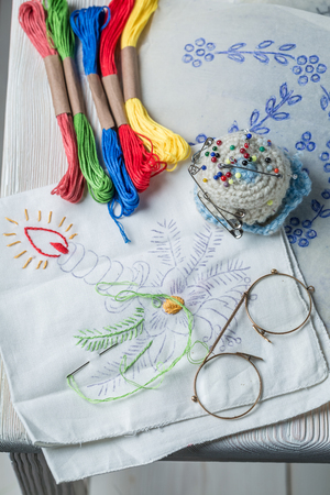 Closeup of color mulinaand homemade embroidered napkins  Stockfoto