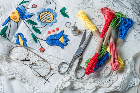 Closeup of embroidered napkins and color mulina Stock Photo