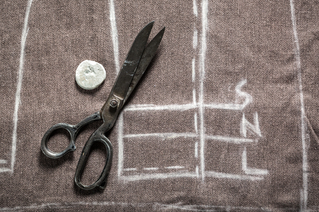 Tailor project of trousers with scissors and chalk Stock Photo