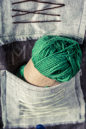 Green skein with yarn in tailor workshop