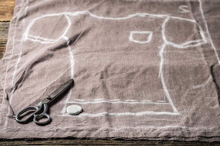 Tailor pattern of shirt and scissors on clothes Stock Photo
