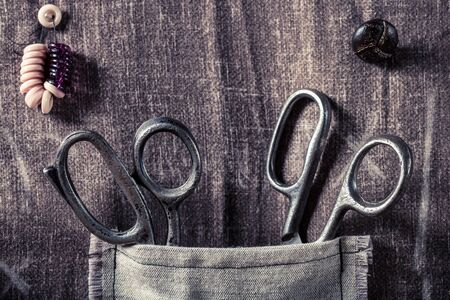 Vintage scissors in small pocket in tailor workshop Stock Photo
