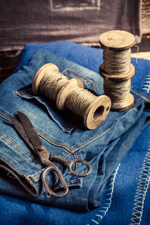 Closeup of cloth and needle in a tailor workshop Stock Photo