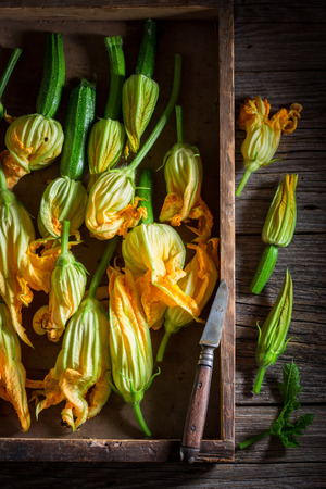 Preparation for homemade roasted zucchini flower made of pancake batter