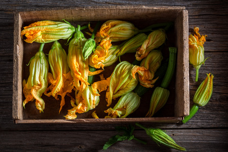 Preparation for tasty fried zucchini flower made of pancake batter