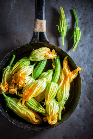Ingredients for yummy roasted zucchini flower made of pancake batter