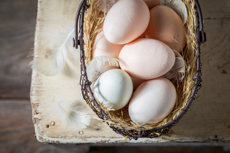 Ecological eggs from the countryside in old basket Stock Photo