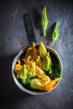 Ingredients for homemade fried zucchini flower made of pancake batter