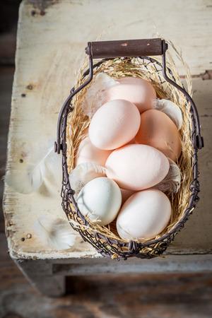 Healthy free range eggs in old basket Stock Photo