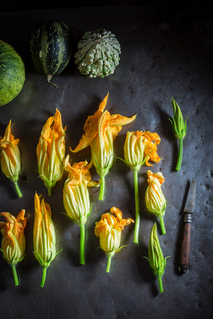 Ingredients for crispy roasted zucchini flower made of pancake batter
