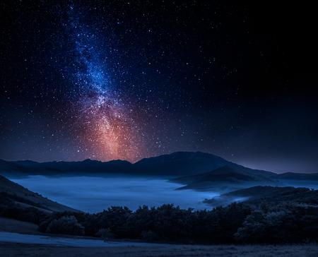 Milky way and foggy valley in Castelluccio, Italy, Umbria
