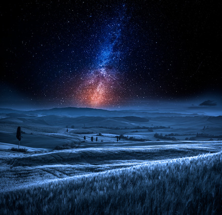 Milky way and field in Italy at night Stock Photo