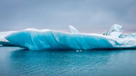 Blue iceberg floating on lake in Iceland 스톡 콘텐츠