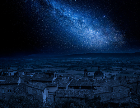 Milky way and Assisi in Umbria, Italy