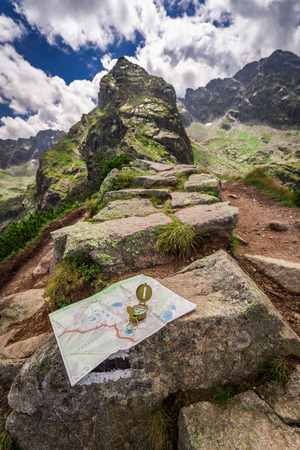 Orientation in mountains with compass and map, Poland, Europe