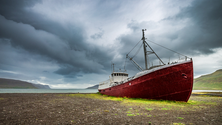 Shipwreck on the shore in cloudy day, Iceland