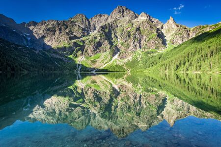 Stunning sunrise at lake in the Tatra Mountains, Poland Stock Photo