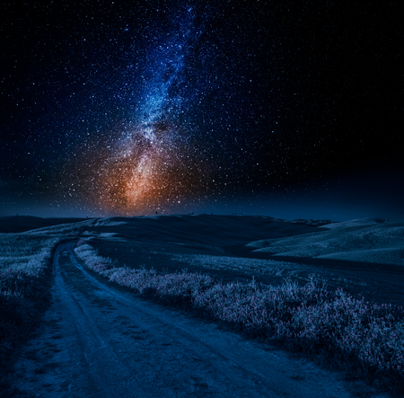 Stunning milky way, road and fields in Italy Stock Photo