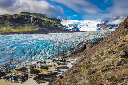 Blue glacier and green mountains in summer, Iceland Reklamní fotografie