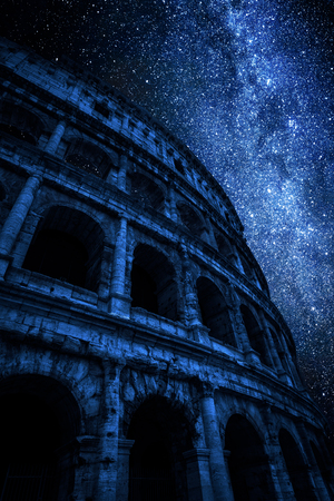 Milky way and great Colosseum at night in Rome, Italy