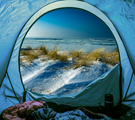 Camping on beach in winter at sea