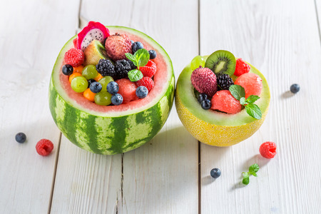 Fruits salad in watermelon in summer on white table Stock Photo