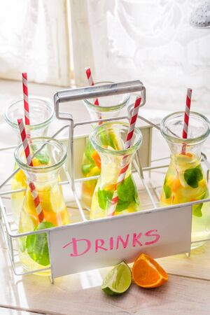 Summer lemonade with citrus fruits on white table Stock Photo