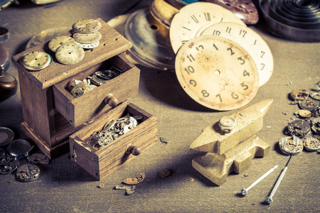 Closeup of aged watchmakers workshop with spare parts