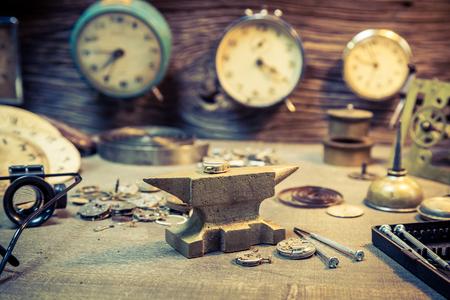 Closeup of fixing damaged clocks in watchmaker workshop
