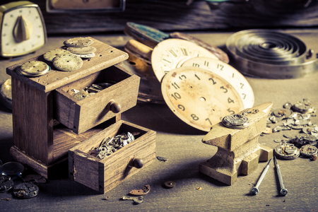 Small watchmakers room with spare parts of clocks