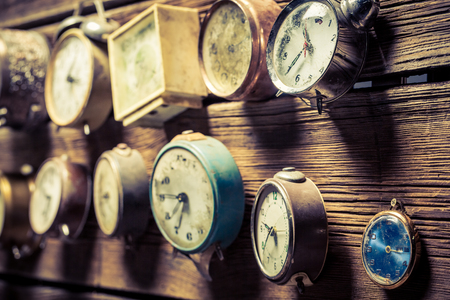 Mix of old clocks on the wooden wall Stock Photo