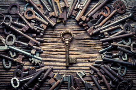 Many metal keys and one golden key as concept 写真素材
