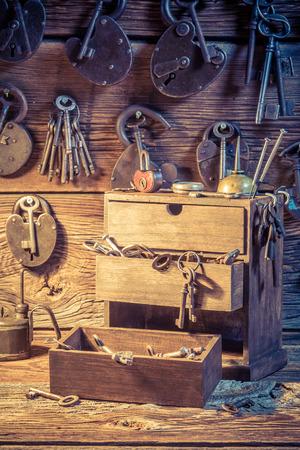 Closeup of tools, locks and keys in locksmiths workshop Standard-Bild - 100136390
