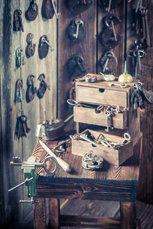 Locksmiths workshop full of old keys, locks Standard-Bild - 100136394