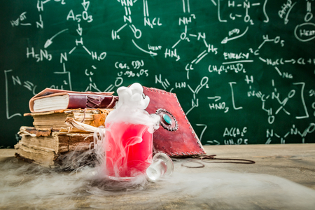 Magic potion created by chemistry in school laboratory Фото со стока - 100136408